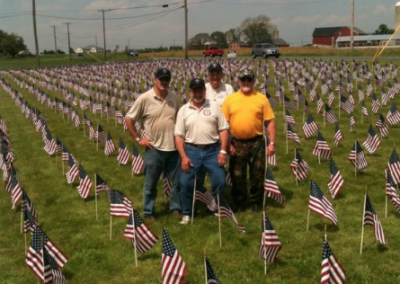 placing flags in front of Kelly Cadillac